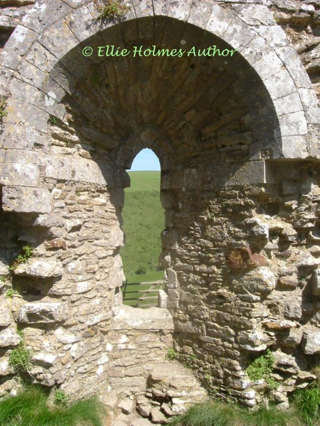 Corfe Castle ruins stone arch - Ellie Holmes Author
