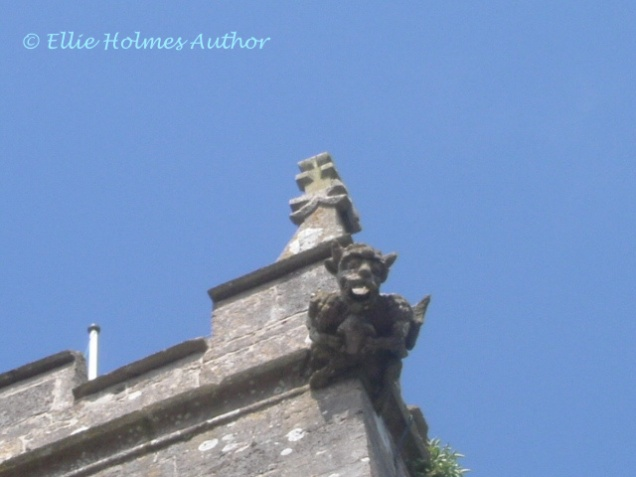 Gargoyle on Church at Corfe Castle - Ellie Holmes Author